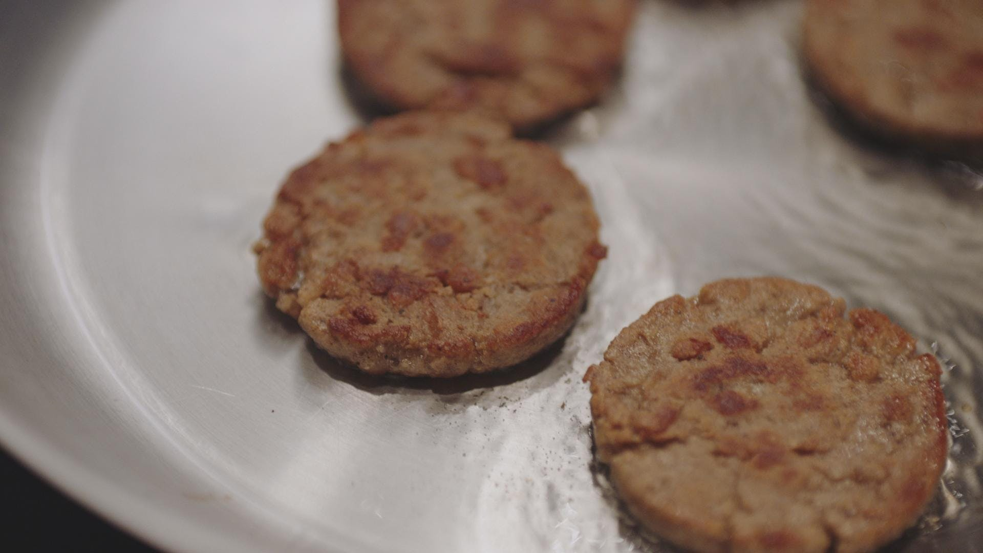 Nature's Fynd meatless breakfast sausage in a frying pan.